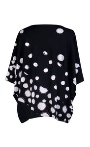 Back view of the alembika multi spotted lia jersey top. This top is black with different types of white spots all over it. The sleeves are 3/4 length and the shirt has an oversized fit.