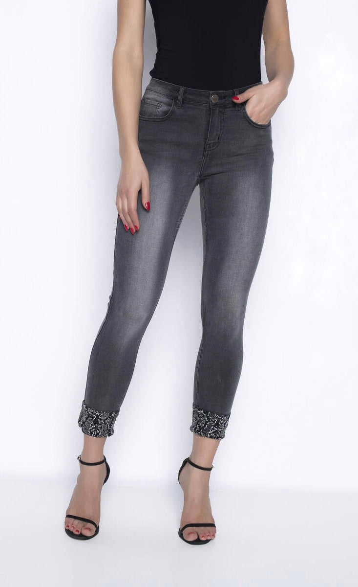 Front view of a woman wearing grey denim cropped jeans from Frank Lyman with rhinestone detailed cuffs.