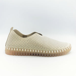 Outer side view of the Ilse Jacobsen flat shoe in creme. This shoe has a gummy sole. The upper features perforated holes and sparkles