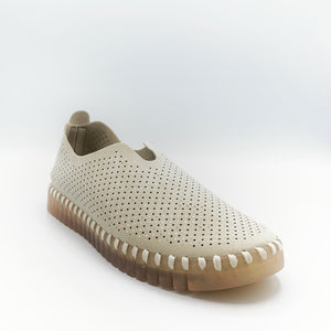Front Outer side view of the Ilse Jacobsen flat shoe in creme. This shoe has a gummy sole. The upper features perforated holes and sparkles