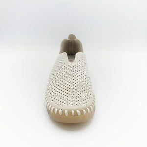 Front view of the Ilse Jacobsen flat shoe in creme. This shoe has a gummy sole. The upper features perforated holes and sparkles