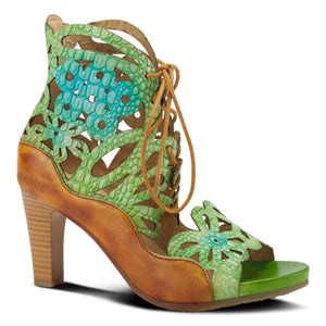 Outer view of the l'artiste osocool sandal. This sandal is an open toe high heel with green and blue floral cutouts through out the upper. The upper goes up to the ankle and has a lace up closure. The sandal also features tan edging.