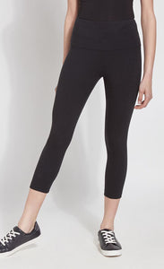 Front bottom half view of a woman wearing Lysse's Flattering Cotton Crop Legging. These leggings are black and have a high-rise, large waistband.