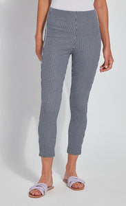 Front bottom half view of a woman wearing the Lysse Toothpick Crop Pattern Legging. These leggings are indigo and white pinstriped and high waisted.