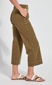 Right side bottom half view of a woman wearing the lysse jade wide leg crop denim pant. This pant is khaki colored. It has side patch pockets with top stitching, a flat front, and a hem that sits above the ankles.