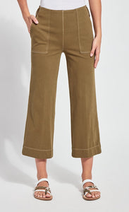 Front bottom half view of a woman wearing the lysse jade wide leg crop denim pant. This pant is khaki colored. It has side patch pockets with top stitching, a flat front, and a hem that sits above the ankles.