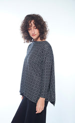 Load image into Gallery viewer, Left side view of woman wearing the black and white printed boxy Karen Top from M x Matthildur