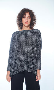 Front view of woman wearing the black and white printed boxy Karen Top from M x Matthildur