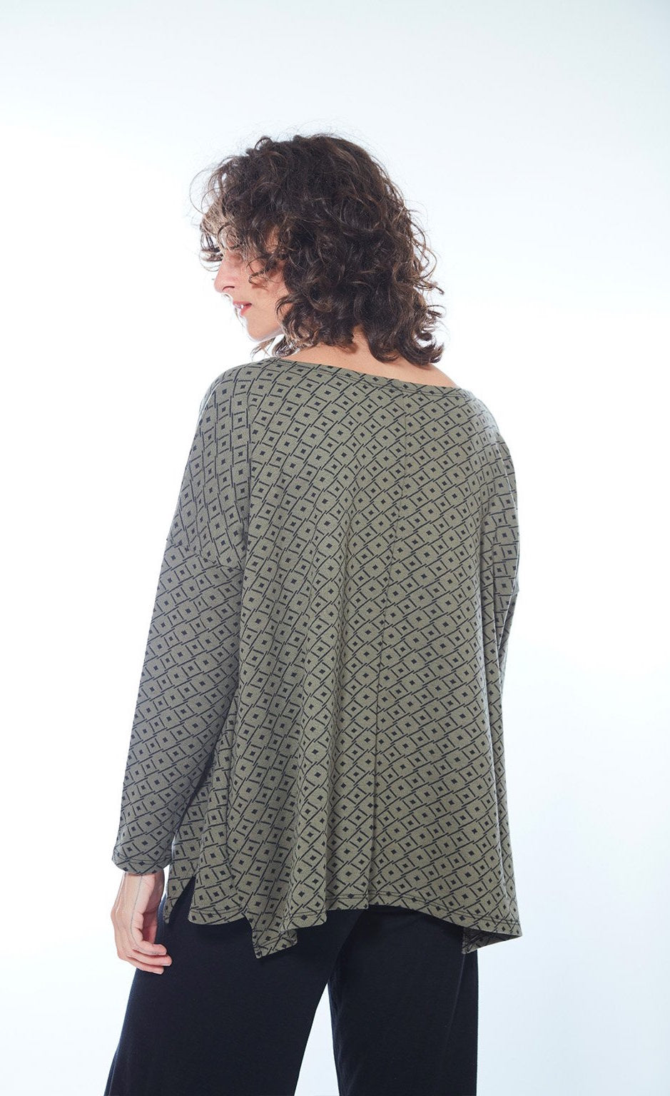 Back view of woman wearing green and black printed boxy Karen Top from M x Matthildur