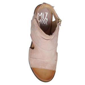 Birds-eye view of the miz mooz anna in the color pearl. This color is a faded pink. The upper covers most of the foot with small exposed sides, an exposed heel, and an open toe.
