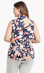 Load image into Gallery viewer, Back, top half view of a woman wearing the nic+zoe all aflutter tank. This sleeveless tank features an abstract indigo and mixed pink print and an inverted back pleat.