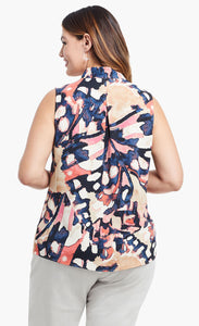 Back, top half view of a woman wearing the nic+zoe all aflutter tank. This sleeveless tank features an abstract indigo and mixed pink print and an inverted back pleat.