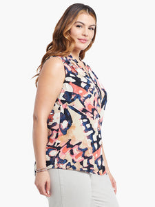 Right side, top half view of a woman wearing the nic+zoe all aflutter tank. This sleeveless tank features an abstract indigo and mixed pink print.