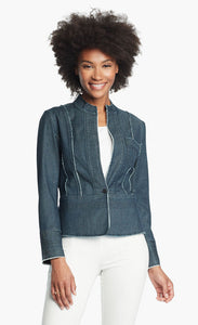 Front, top half view of a woman wearing white pants and the Nic + Zoe Favorite Denim Jacket. The dark denim jacket features frayed stiching, a single front button, and a short stand collar.
