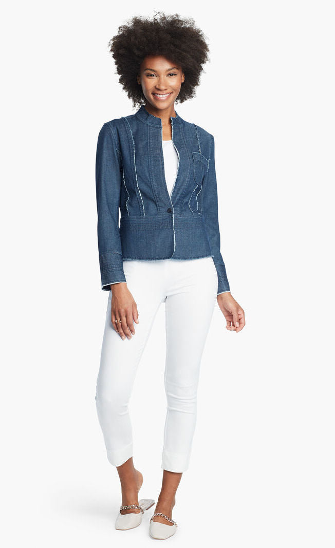 Front, full body view of a woman wearing white pants and the Nic + Zoe Favorite Denim Jacket over a white top. The dark denim jacket features frayed stitching, a single front button, and a short stand collar.