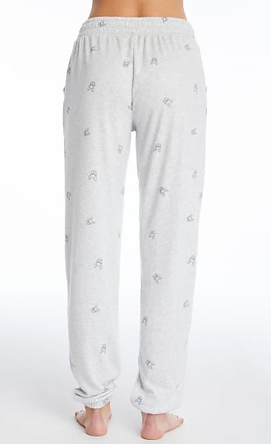 Back bottom half view of a woman wearing the PJ Salvage Lily Rose Banded Pant. The banded pant is a heathered light grey with tiny french bulldog faces printed on it in black.