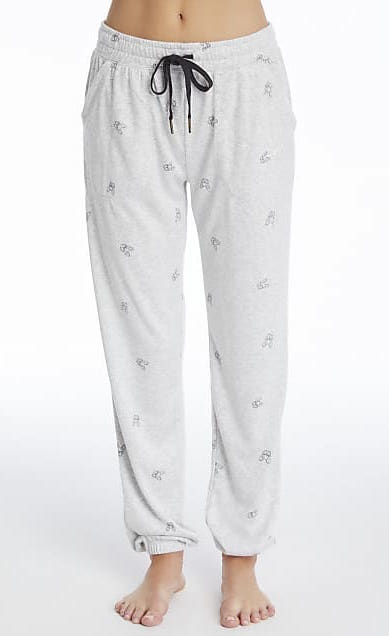 Front bottom half view of a woman wearing the PJ Salvage Lily Rose Banded Pant. The banded pant is a heathered light grey with tiny french bulldog faces printed on it in black and a black tie waistband