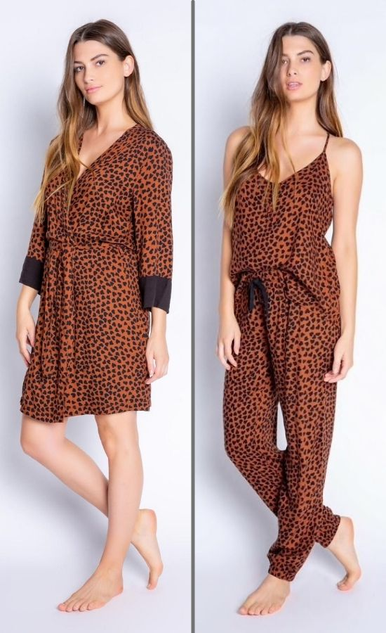 Front full body view of woman wearing the PJ Salvage Wild Love Robe on the left side and the wild robe top and banded pant on the right side. The short, mocha/brown colored robe and top and bottom have a heart shaped animal print all over them. The robe has contrasting black sleeves, and a belt at the waist. The top has thin straps and button detailing in the front. The Banded Pant has a black tie waistband.