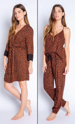 Load image into Gallery viewer, Front full body view of woman wearing the PJ Salvage Wild Love Robe on the left side and the wild robe top and banded pant on the right side. The short, mocha/brown colored robe and top and bottom have a heart shaped animal print all over them. The robe has contrasting black sleeves, and a belt at the waist. The top has thin straps and button detailing in the front. The Banded Pant has a black tie waistband.