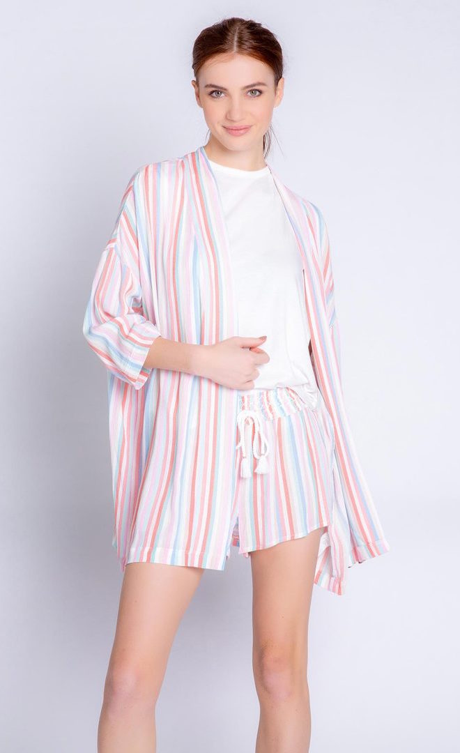 Front full body view of a woman wearing the pj salvage saturday morning stripe jacket. This jacket has multicolored stripes, a draped open front, and 3/4 length drop shoulder sleeves. on the bottom the model is wearing matching shorts.