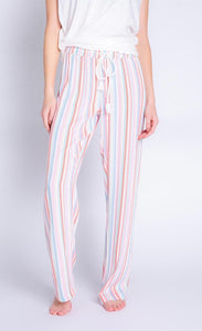 Front bottom half view of a woman wearing the saturday morning stripe pant. This pant is striped with a white adjustable tie waistband.