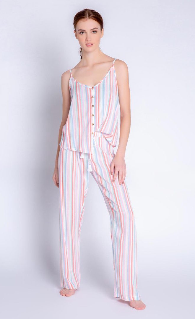 Front full body view of a woman wearing the saturday morning stripe set. This set includes the saturday morning stripe tank and the saturday morning stripe pant. This pj set is multicolored striped.