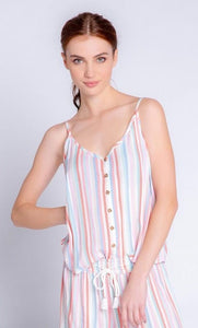Front top half view of a woman wearing the saturday morning stripe tank. This tank has a button down front, thin straps, and a v-neck.