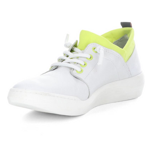 Inner front view of the softino byra sneaker. This sneaker is white with a neon green layer of fabric around the opening. The shoes has non-functional white laces.