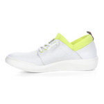 Load image into Gallery viewer, Inner view of the softino byra sneaker. This sneaker is white with a neon green layer of fabric around the opening. The shoes has non-functional white laces.