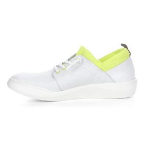 Inner view of the softino byra sneaker. This sneaker is white with a neon green layer of fabric around the opening. The shoes has non-functional white laces.