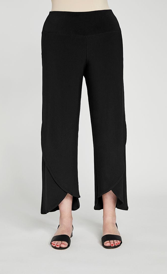 Front bottom half view of a woman wearing the sympli narrow rapt pant. These pants are black and feature side pockets, a wide waistband, a wrapped look near the hem, and a relaxed, straight silhouette