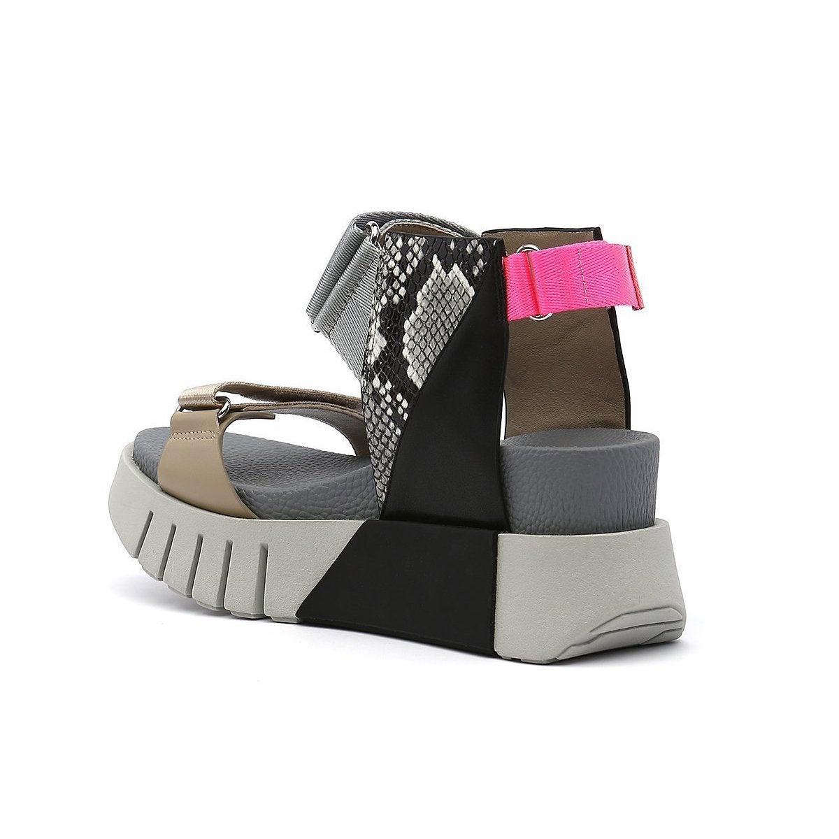 Inner back view of the united nude delta run sandal. This sandal is grey with gold, black, snake print, and a touch of hot pink. The sandal has a white platform sole and adjustable back, ankle, and toe bed straps.