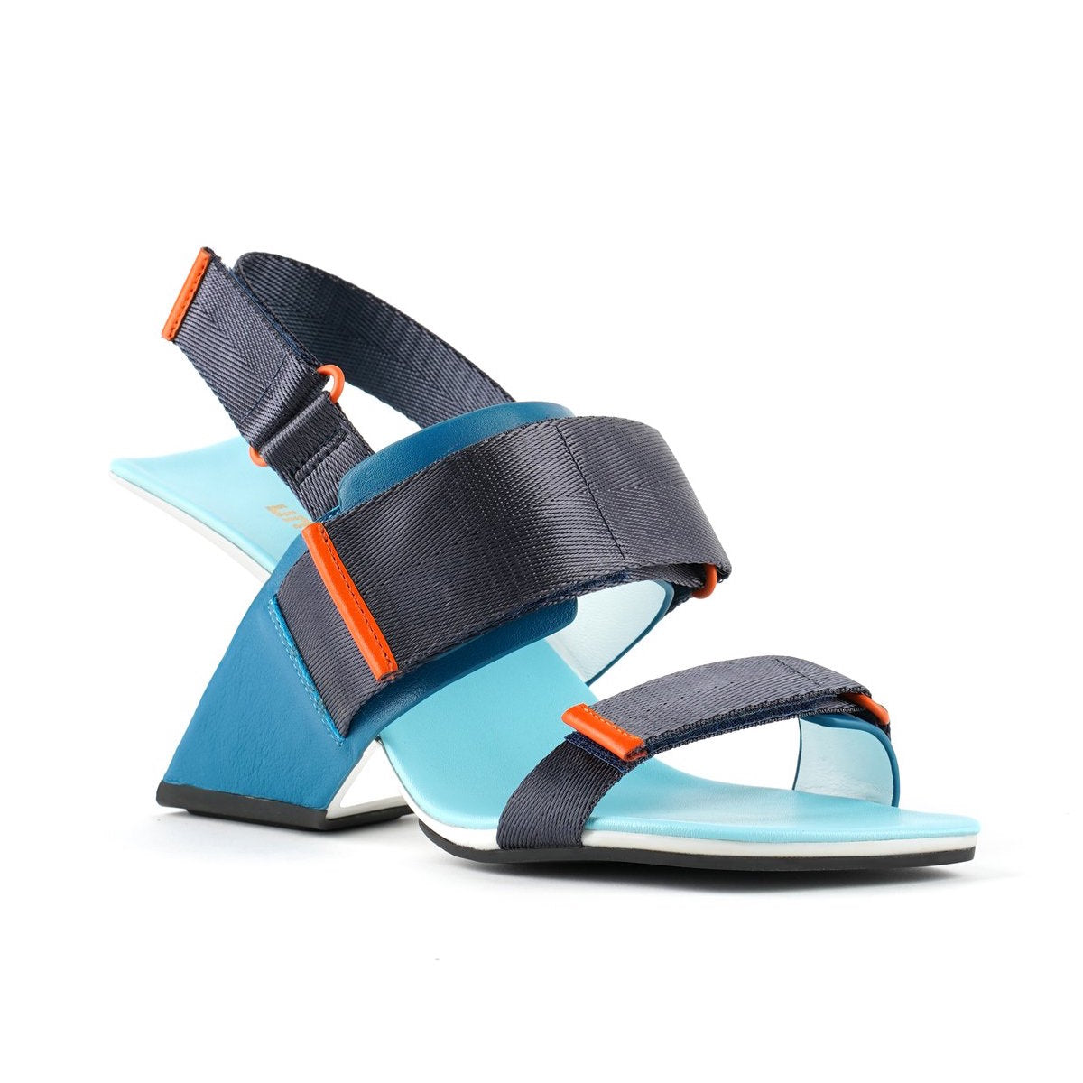 Outer front view of the united nude loop run high heel sandal. This sandal is blue with a black back strap, a black strap over the instep, and a black strap over the toes.