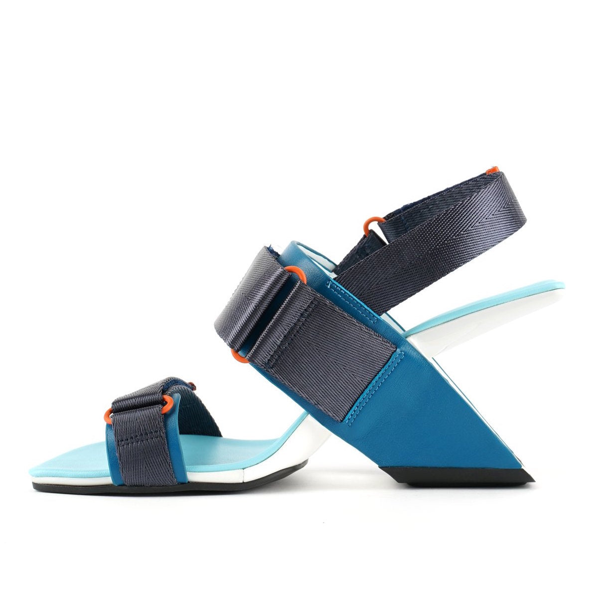 Inner view of the united nude loop run high heel sandal. This sandal is blue with a black back strap, a black strap over the instep, and a black strap over the toes.