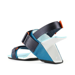 Inner back view of the united nude loop run high heel sandal. This sandal is blue with a black back strap, a black strap over the instep, and a black strap over the toes.
