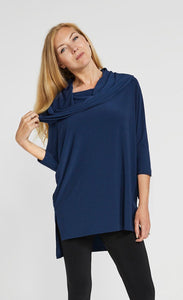 Front angle of woman pulling on cowl neck collar of denim whipser tunic from Sympli