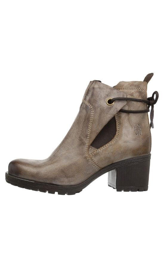 Inner side view of Brown Luxe Boot from Fly London. Boot has a chunky heel and a leather upper that layers over each other and stays in place with a tie in the back