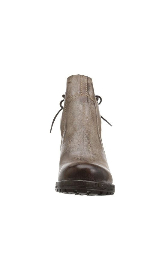 Front view of Brown Luxe Boot from Fly London. Boot has a chunky heel and a leather upper that layers over each other and stays in place with a tie in the back