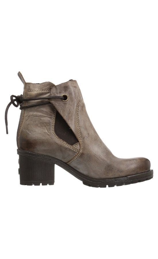 Outer side view of Brown Luxe Boot from Fly London. Boot has a chunky heel and a leather upper that layers over each other and stays in place with a tie in the back
