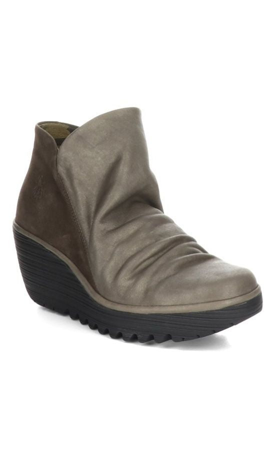Outer front view of two toned wedge Yip Boot from Fly London. The front portion of the boot is a slouchy metallic grey leather while the back is a brown suede leather.