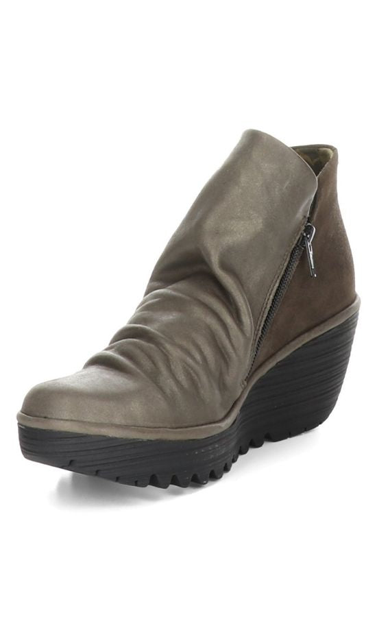 Inner front view of two toned wedge Yip Boot from Fly London. The front portion of the boot is a slouchy metallic grey leather while the back is a brown suede leather.