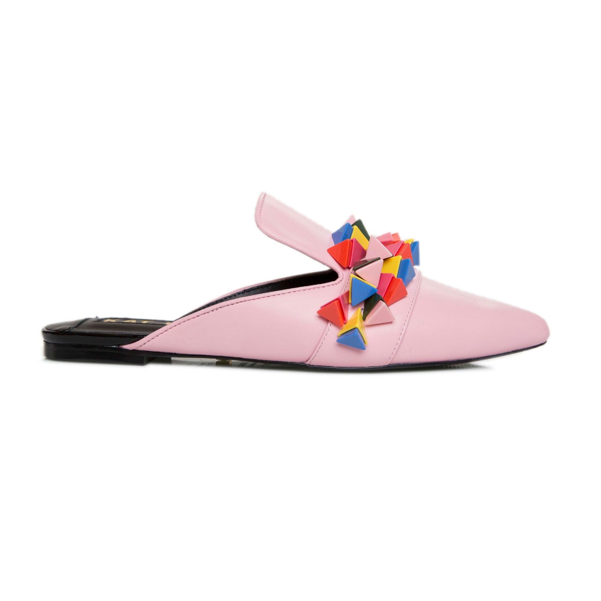 Outer side view of the kat maconie issa mule. This slip on mule is pink with multicolored tiny pyramid shaped decorations on the upper. The shoe has a pointed toe.