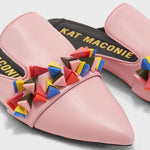 Load image into Gallery viewer, Close up view of a pair of the kat maconie issa mule. This slip on mule is pink with multicolored tiny pyramid shaped decorations on the upper. The shoe has a pointed toe.