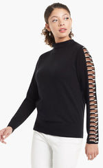 Load image into Gallery viewer, Woman wearing a black sweater with sheer side paneling on the long sleeves and a mock neck from Nic and Zoe