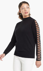 Woman wearing a black sweater with sheer side paneling on the long sleeves and a mock neck from Nic and Zoe