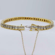 Load image into Gallery viewer, 5 CT. T.W. PRINCESS CUT DIAMOND TENNIS BRACELET in 14K YELLOW GOLD 4.9mm 7""
