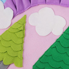 Details of rainbow forest dog sniffing and training mat, clouds and trees
