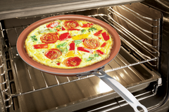 Copper ceramic crepe pan with omelette in the oven