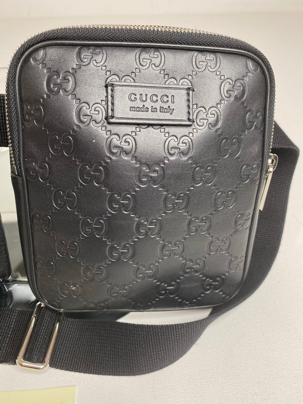Gucci Signature Embossed Leather Belt Bag in Black