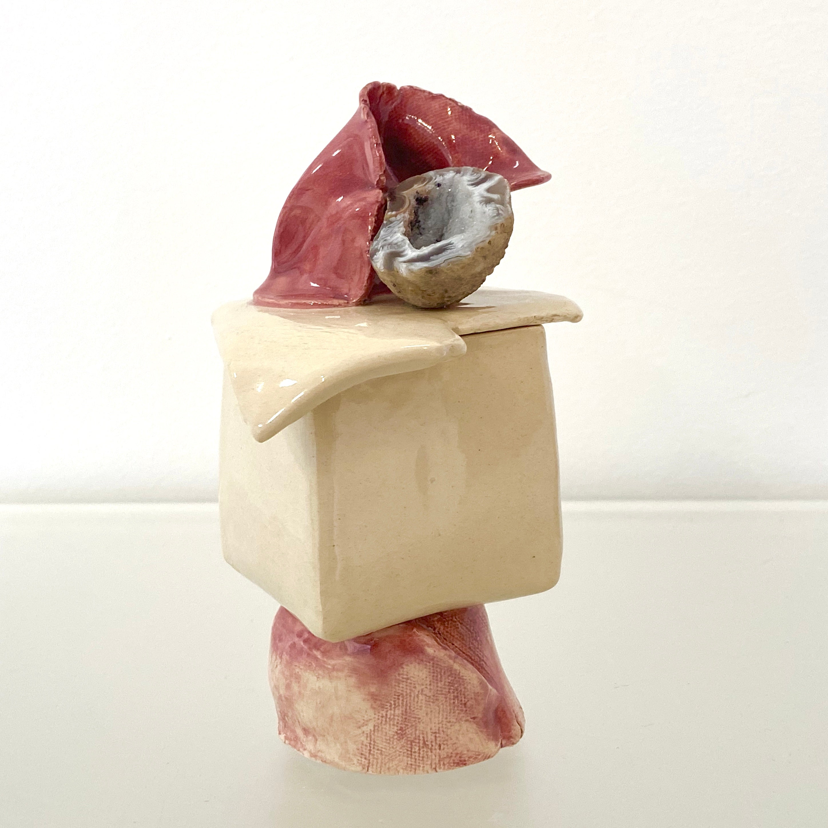 Small White and Red Sculpture with Geode